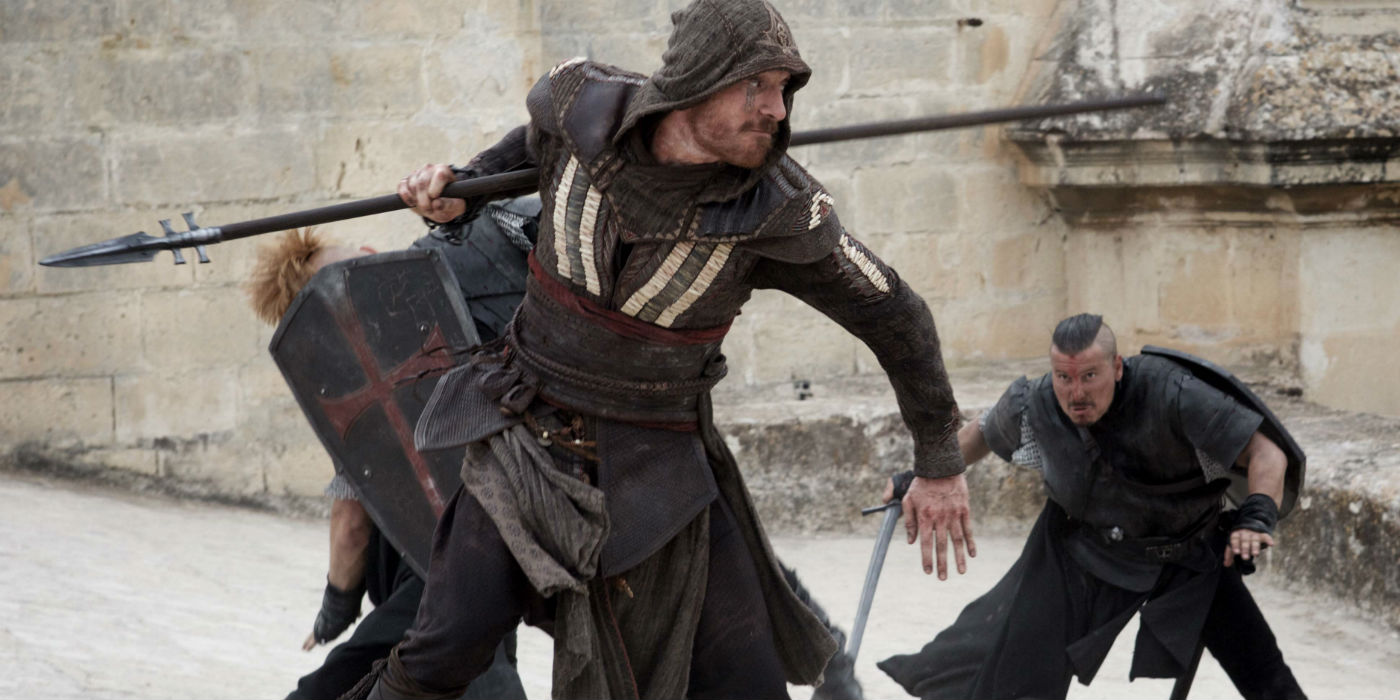 Michael Fassbender holding a spear.